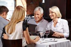 Senior couple with family Stock Photo