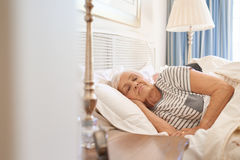 Senior couple fast asleep together in their bed royalty free stock photography