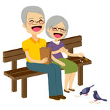 Senior Couple Feeding Birds Stock Images