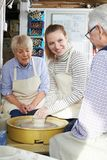 Senior Couple With Teacher In Pottery Class. Senior Couple With Female Teacher In Pottery Class royalty free stock photography