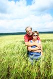 Senior couple in field Stock Photo