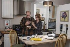 Senior couple with finances Stock Photos