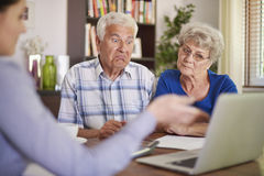 Senior couple with financial advisor royalty free stock images