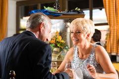 Senior couple fine dining in restaurant Stock Photo