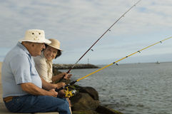 Senior Couple Fishing At The Beach Royalty Free Stock Images