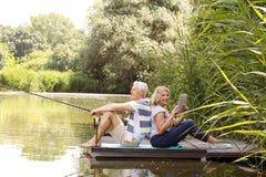 Senior couple fishing Stock Photography