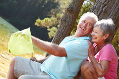Senior couple fishing together smiling Stock Photography