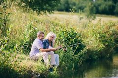Senior couple fishing by the water. Stock Image