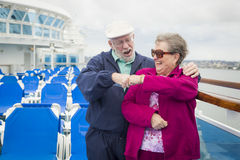 Senior Couple Fist Bump on Deck of Cruise Ship Stock Photo