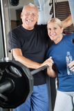 Senior couple in fitness center Stock Photo
