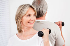 Senior couple in fitness class Stock Photo