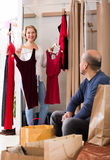 Senior couple in fitting room. Portrait of positive senior couple in fitting room at boutique Royalty Free Stock Images