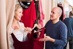 Senior couple in fitting room. Portrait of smiling senior couple in fitting room at boutique Royalty Free Stock Photography