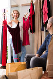 Senior couple in fitting room. Portrait of smiling senior couple trying on new wear in fitting room at boutique Stock Image