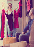 Senior couple in fitting room. Portrait of smiling senior couple trying on new wear in fitting room at boutique Royalty Free Stock Image
