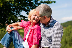 Senior couple flirting and having fun Royalty Free Stock Image