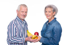 Senior couple with food Royalty Free Stock Photos
