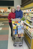 Senior Couple Food Shopping In Supermarket Stock Photography