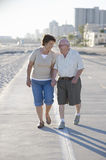 Senior Couple On Footpath Along Beach Stock Photography