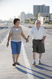Senior Couple On Footpath Along Beach Stock Photos