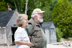 Senior couple in front of boathouses Royalty Free Stock Images
