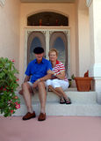 Senior couple on front porch Stock Photos
