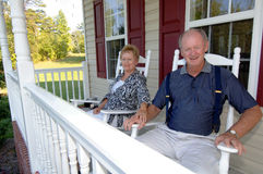 Senior couple on front porch Stock Images