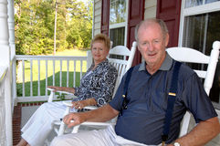 Senior couple on front porch royalty free stock photography