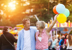 Senior couple at the fun fair Royalty Free Stock Images