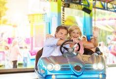 Senior couple at the fun fair Royalty Free Stock Photos
