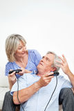 Senior couple with game controller Stock Image