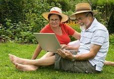 Senior couple in garden stock photography