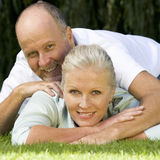 A senior couple in a garden Royalty Free Stock Image
