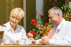 Senior couple in garden with coffee Stock Image