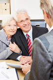 Senior couple getting advice from Royalty Free Stock Photo