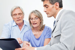 Senior couple getting financial. Advice from consultant at home Stock Photography