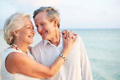 Senior Couple Getting Married In Beach Ceremony. Walking Along Beach Royalty Free Stock Photography