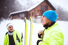 Senior couple getting ready for cross-country skiing. Stock Images