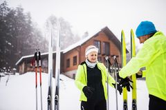 Senior couple getting ready for cross-country skiing. Stock Image