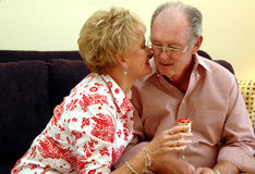 Senior couple gift giving Stock Photos