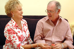 Senior couple gift giving Royalty Free Stock Photography
