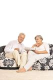 Senior couple with gift Stock Images