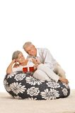 Senior couple with gift Royalty Free Stock Photo