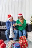Senior couple give gift box christmas present Stock Image