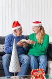 Senior couple give gift box christmas present Stock Photography