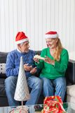 Senior couple give gift box christmas present Stock Photos