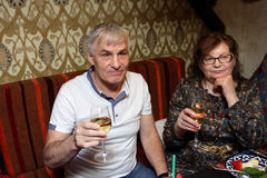 Senior couple with glasses of white wine Stock Images