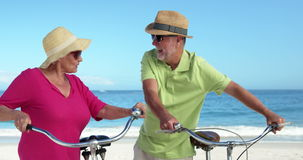 Senior couple going for a bike ride stock footage