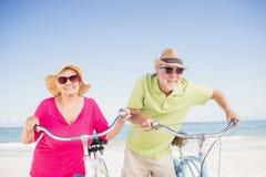 Senior couple going for a bike ride Stock Photos