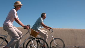 Senior couple going on a bike ride on the pier stock footage